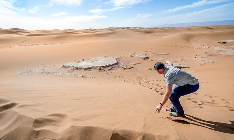 Sandboarding in Red Dunes, Empty Quarter, Rub' al-Khali